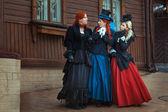 Three girls in retro dresses. — Stock Photo