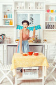 Retro woman with a rolling pin. — Stock Photo