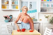 Serious woman with a rolling pin. — Stock Photo