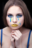 Yellow blue tears of the girl. — Stock Photo