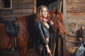 Girl in leather jacket with a horse. — Stock Photo