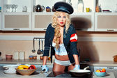 Blonde girl in the kitchen. — Stock Photo