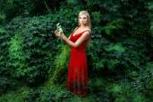 The girl in the red dress forest. — Stock Photo
