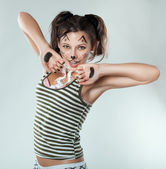 Mischievous girl painted like a cat. — Stock Photo