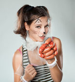 Girl with cat muzzle in his hand holding sausages. — Stock Photo
