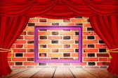 Frame on the background of  Red curtains on  brick wall. — Stock Photo