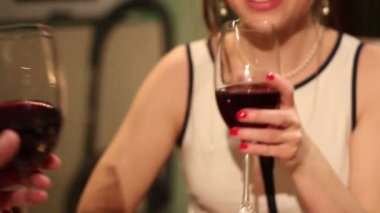 Girl clinking wineglasses with boyfriend — Stockvideo