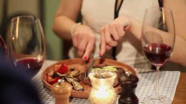 Woman enjoying steak in restaurant — Stock Video