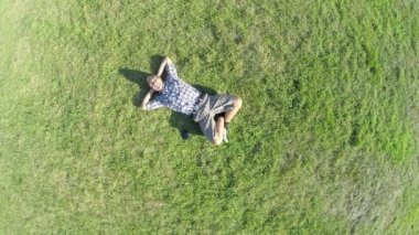 Aerial of man lying on grass — Stock Video