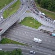 Aerial shot of busy road junction — Stock Video #57083387
