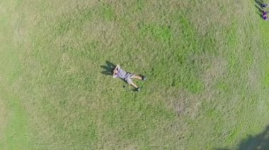 Young guy sleeping on grass — Stock Video