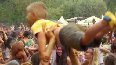 Parent spinning boy in air at festival — Stock video