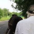 Man in cap riding horse — Stock Video #63977323