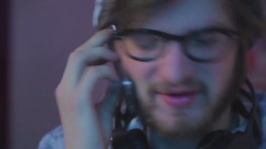Male in glasses talking by phone — Stock Video