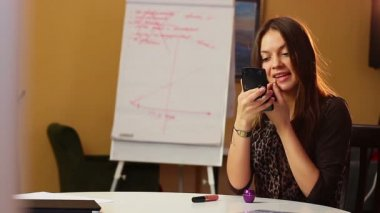 Businesswoman painting lips — Stok video