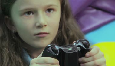 Child playing video games — Stock Video