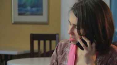 Divorced woman talking by phone — Stock Video