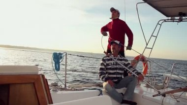 Father and son on yacht — Stock Video