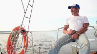 Senior captain on sailboat — Stockvideo