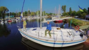 Men on a small sailboat — Stock Video