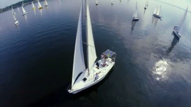 Sailing yachts on calm water — Stock Video