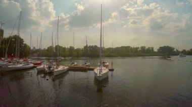 Sailboats in small city port — Stock Video