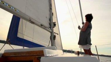 Sailor watching sunset on yacht — Stock Video