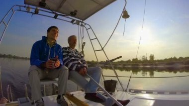 Men yachting on river — Stock Video