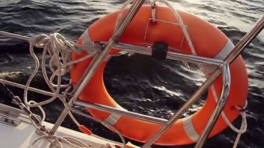 Orange life ring on board of yacht — Stock Video