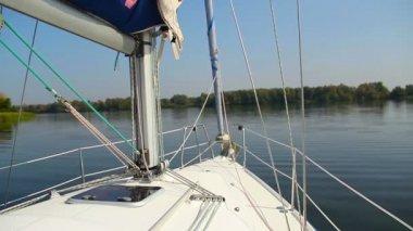Yacht cruising on river — Stock Video