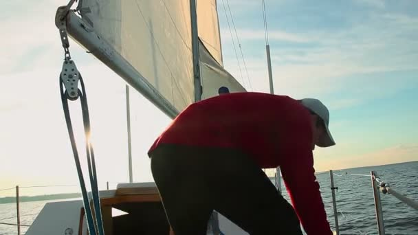 Sailor helping out captain on boat — Vidéo