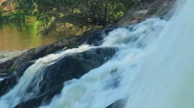 Water torrent running into river — Stock Video
