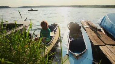 Girl waiting in boat — Stock Video
