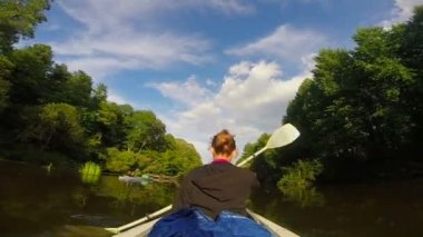 Girl paddling boat on river — Stock Video