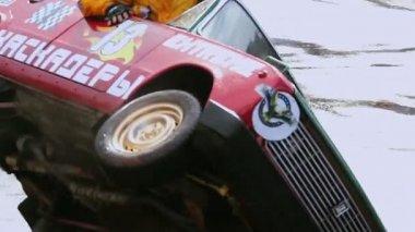Stunt performer climbs out of car — Vídeo de stock
