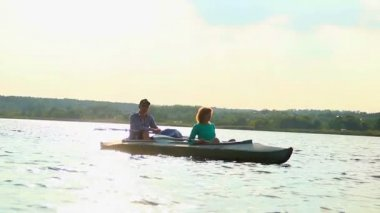 Relaxed couple sitting in boat — Stock Video