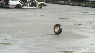 Car wheel rolling on asphalt — Stock Video