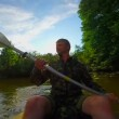 Man paddling canoe — Stock Video #65056107