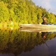 Man and woman paddling canoe — Stock Video #65056113
