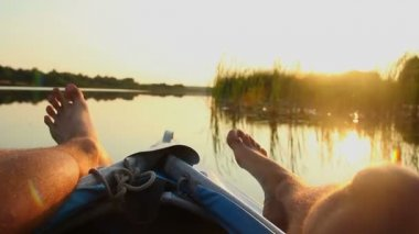 Tourist moving feet playfully during a boat ride — Stock Video