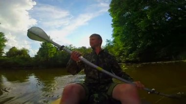 Man paddling canoe — Stock Video