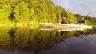 Man and woman paddling canoe — Stock Video