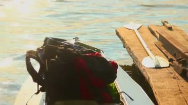 Tourist backpack in canoe — Stok video