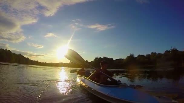 Tourists paddling boat — Vidéo