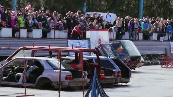 Stuntman climbs out of moving car — Vídeo de stock