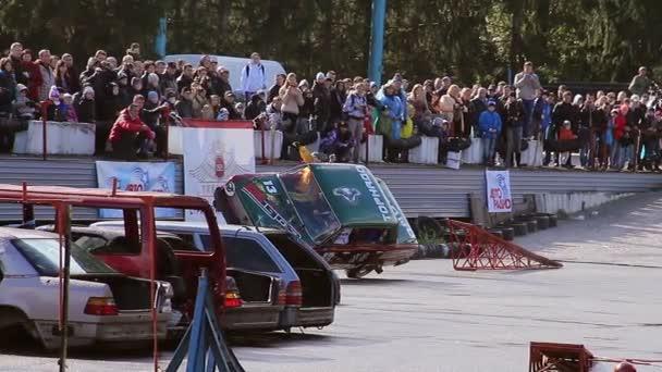 Stuntmen climb out of car — Vídeo de stock