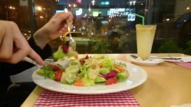 Guy enjoying appetizing salad, eating out, having low-fat dinner — Stock Video