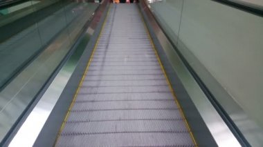 Modern escalator moving up at business, shopping center, airport — Stockvideo