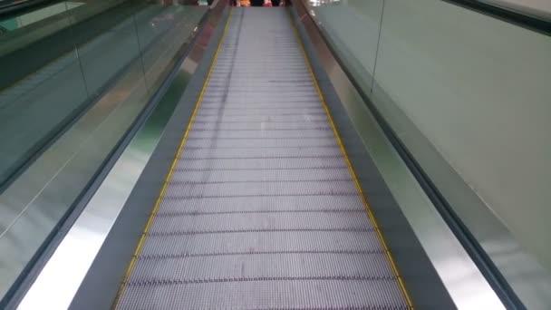 Modern escalator moving up at business, shopping center, airport — Vidéo