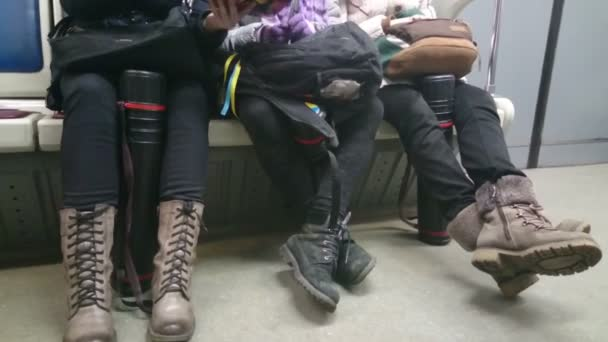 Ordinary people in subway, commuters sitting in metro train — Vídeo de stock